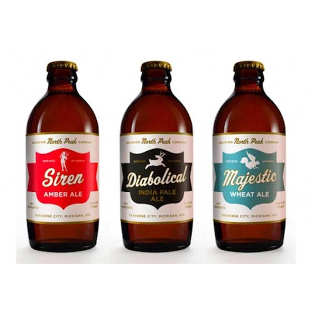 A picture of 3 bottles of beer showing Beer Bottle Labels