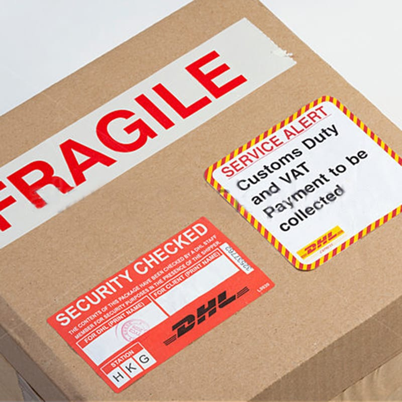 Delivery labels in situ on a box