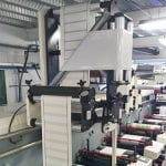 Image of turnbar equipment for double-sided labels
